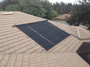 Fort Myers Tile Roof with Solar Pool Panels for a Swimming Pool