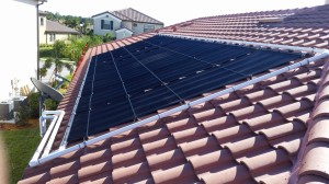 Naples Tile Roof Home with Solar Pool Heating Panels